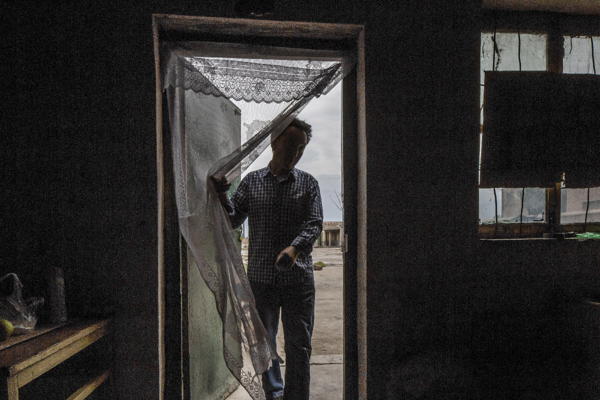 Ouvrier dans son logement, Yumen
